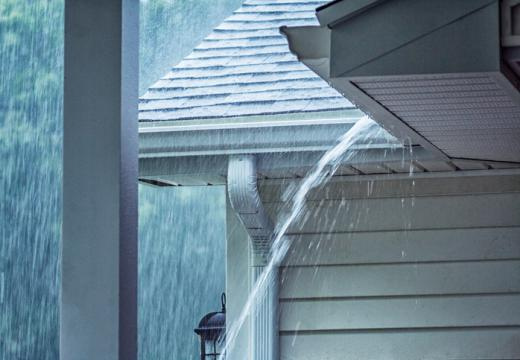 Heavy rainwater overflowing eavestroughs