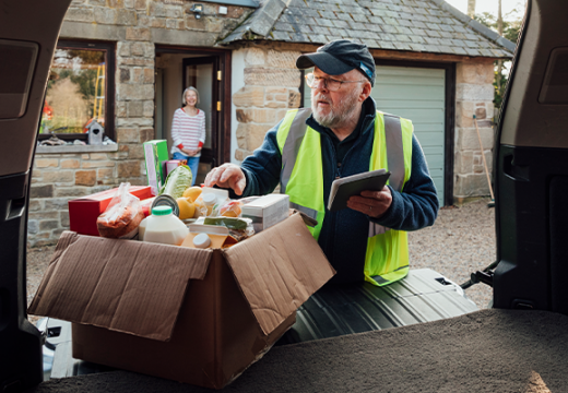 Man delivering food to house