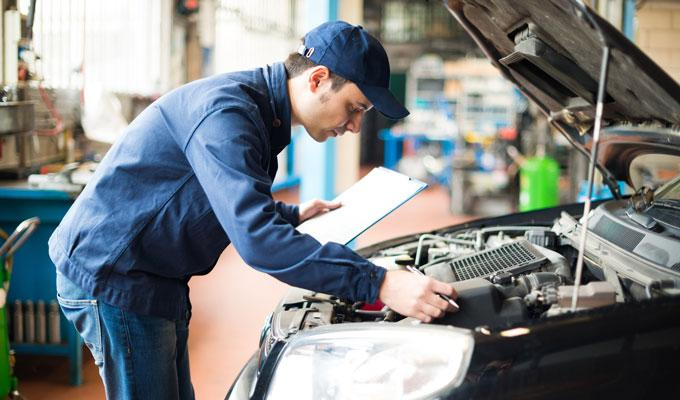 Mechanic working CAA Appoved Auto Repair Services