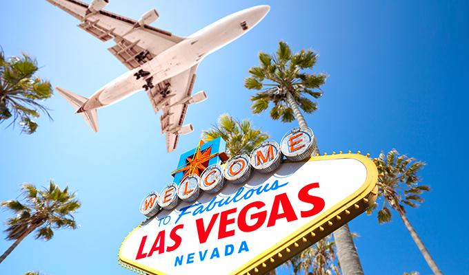Plane over Las Vegas Sign