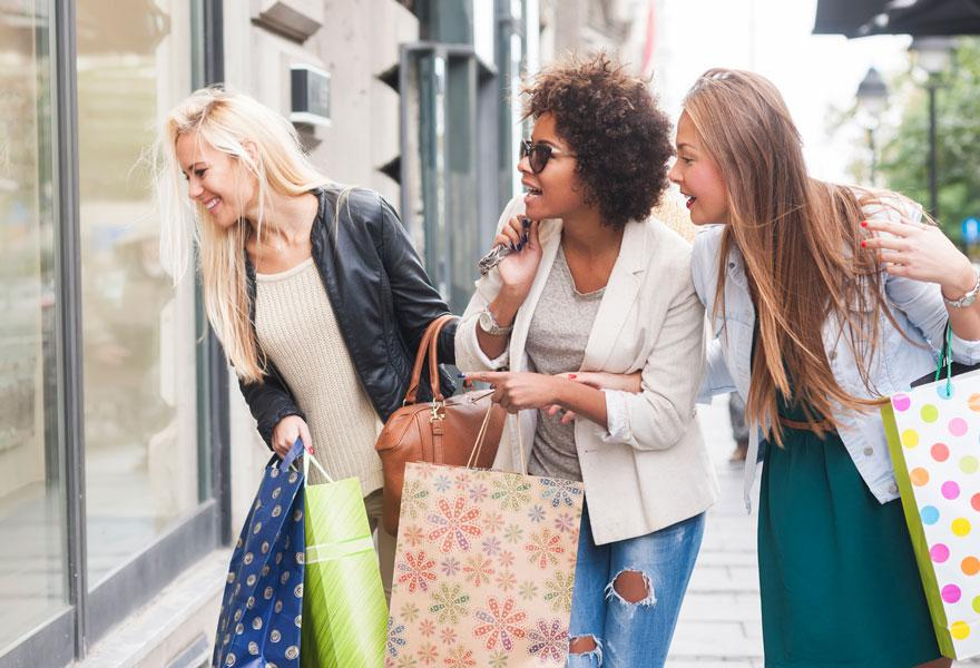 Women shopping and earning CAA Dollars