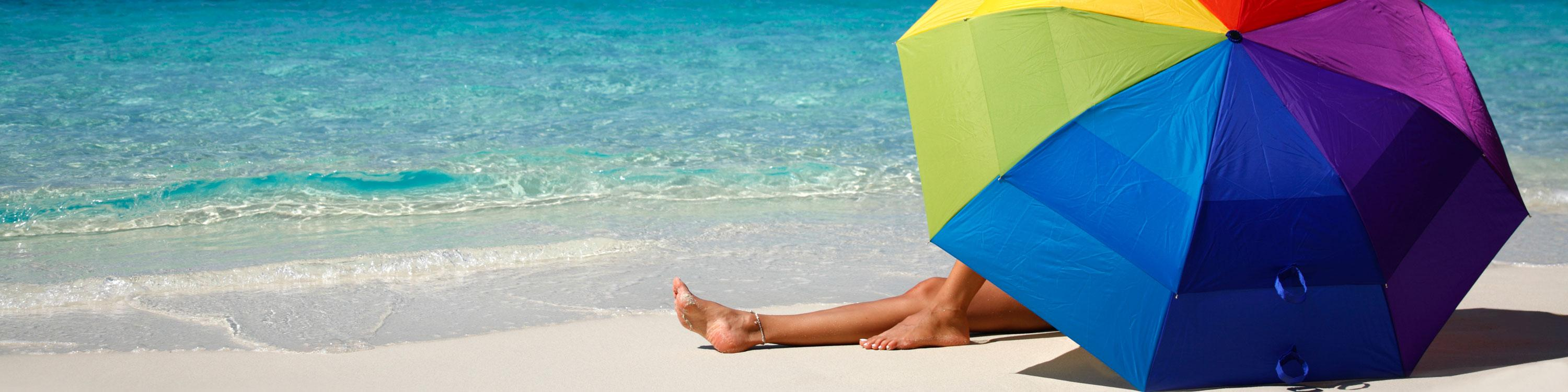 Umbrella on Beach, CAA Travel Insurance